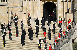 The Princess Royal, the Prince of Wales, the Duke of York, the Earl of Wessex, the Duke of Cambridge, Peter Phillips, the Duke of Sussex, the Earl of Snowdon and Vice Admiral Sir Timothy Laurence climb the steps to St George's Chapel, Windsor Castle, Berkshire, ahead of the funeral of the Duke of Edinburgh. Picture date: Saturday April 17, 2021.