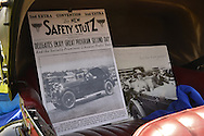Old Westbury, New York, U.S. - June 1, 2014 - Winner of the Best in Show for Post War is a one-of-a-kind 1926 Stutz, owner STEVEN GITTELMAN of HUNTINGTON, at the Antique and Collectible Auto Show held on the historic grounds of elegant Old Westbury Gardens in Long Island, and sponsored by Greater New York Region AACA Antique Automobile Club of America. The posters in car include historical photos of the unique car custom built for Grace and General Cornelius Vanderbilt III, and the only known one with a Victoria Top.