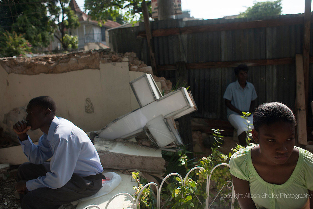 Worshippers participate in a Catholic mass from the debris of the Sacre Coeur Catholic church in Port-au-Prince, Haiti, February 28, 2010.  The church was ruined in the January 12 earthquake, and makeshift services are now held outdoors.