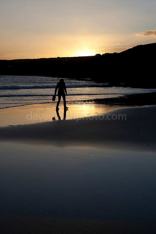 "Woman walking on Red Strand, in Dunowen, near Galley Head, West Cork This mage can be licensed via Millennium Images. Contact me for more details, or email mail@milim.com For prints, contact me, or click ""add to cart"" to some standard print options."