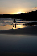 """Woman walking on Red Strand, in Dunowen, near Galley Head, West Cork This mage can be licensed via Millennium Images. Contact me for more details, or email mail@milim.com For prints, contact me, or click """"add to cart"""" to some standard print options."""