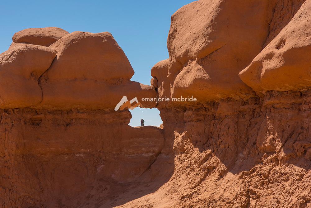 Couple in a window or arch formation at Goblin Valley State Park, Utah.