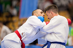 Ferat Korbuljikji of Macedonia (red) fighting against Janez Perhavec of Slovenia (blue) during Kumite Individual male Seniors -75 kg at Day One of Karate 1 World Cup - Thermana Slovenia Lasko 2014 tournament, on March 15, 2014 in Arena Tri Lilije, Lasko, Slovenia.Photo by Vid Ponikvar / Sportida