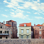"""A row of weathered brick houses within the old city walls of Dubrovnik, Croatia.<br /> <br /> Dubrovnik serves as the official setting of """"King's Landing"""" from the popular TV show """"Game of Thrones"""".<br /> <br /> + ART PRINTS +<br /> To order prints or cards of this image, visit:<br /> http://greg-stechishin.artistwebsites.com/featured/little-boxes-greg-stechishin.html"""