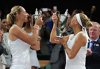 Tennis - 2017 Wimbledon Championships - Week Two, Saturday [Day Twelve]<br /> <br /> Ladies Doubles Final match<br /> <br /> Hao - Ching Chan (TPE) and Monica Niculescu (ROU) vs.Ekaterina Makarova (RUS) and Elena Vesnina (RUS) <br /> <br /> Elena Vesnina  and Ekaterina Makarova kiss their winners trophies on  Centre court <br /> <br /> COLORSPORT/ANDREW COWIE