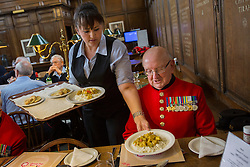 © licensed to London News Pictures. London, UK 02/10/2012. Chelsea Pensioners served curry meal as they launch The Soldiers' Charity Big Curry season with a special Big Curry lunch at Royal Hospital Chelsea's Royal Hall in London on 02/10/12. (Names: (left to right) Hackett Ray, John Clavim, Wayne Campbell, David Donaghey) Photo credit: Tolga Akmen/LNP