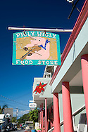 Pidly Wigly, a sign for the main grocery store in Dunmore Town, Harbour Island, The Bahamas