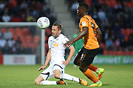 Gylfi Sigurdsson of Swansea city (L) in action with Alex Nicholls of Barnet (R). Pre-season friendly match, Barnet v Swansea city at the Hive in London on Wednesday 12th July 2017.<br /> pic by Steffan Bowen, Andrew Orchard sports photography.