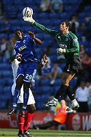 Photo: Pete Lorence.<br />Leicester City v Portsmouth. Pre Season Friendly. 04/08/2007.<br />David James clears the ball from Reneil Sappleton.