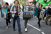 Photographer Gideon Mendel and some of his flood victim portraits Drowning World during the climate Change protest with Extinction Rebellion blocking Oxford Street and simultaneously stop traffic across central London including Marble Arch, Piccadilly Circus, Waterloo Bridge and roads around Parliament Square, on 15th April 2019, in London, England.
