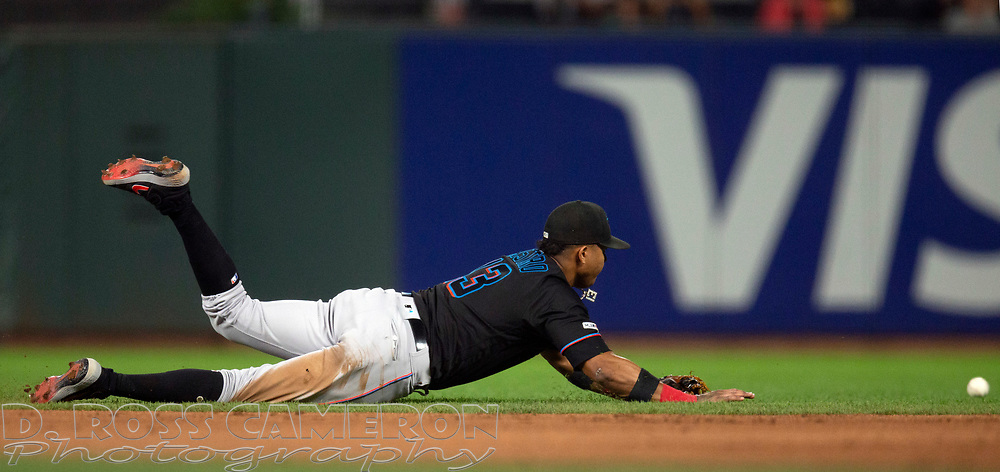 Sep 13, 2019; San Francisco, CA, USA; Miami Marlins third baseman Starlin Castro (13) dives in vain for a single off the bat of San Francisco Giants Stephen Vogt during the second inning of a baseball game at Oracle Park. Mandatory Credit: D. Ross Cameron-USA TODAY Sports