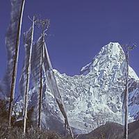 NEPAL, Himalaya. Tibetan Buddhist prayer flags & 6,812 meter (22,349') Ama Dablam, Khumbu region, Nepal.