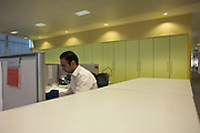 An employee works diligently in an open plan office at an auditing company's London headquarters
