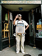 NEW ORLEANS, LA – OCTOBER 28, 2009: New Orleans acoustic blues musician Washboard Chaz Leary stands in front of The Spotted Cat Music Club.