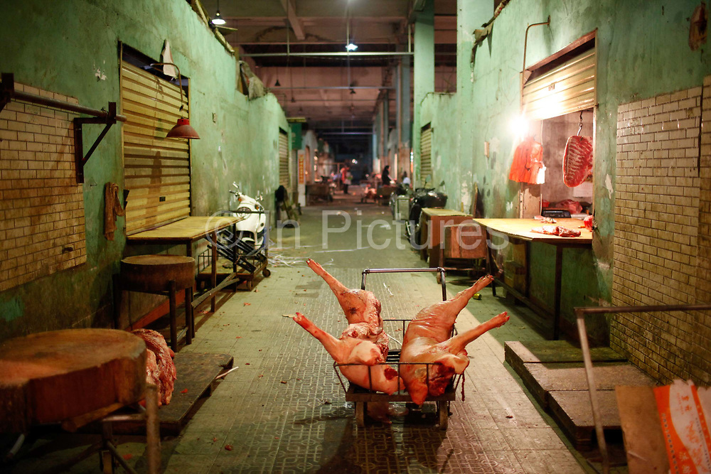 A  pig carcass sits on a cart at a meat wholesale and distribution center in Shanghai, China on 03 March, 2011.  Inflation, especially the persistent rise of food prices, has been a major conversation topic for China's masses and concern for its leaders as inflation often lead to political instability throughout China's history.