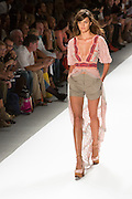 Women's shorts and lace top with a plunging neckline and a floor-length lace train. By Custo Barcelona at the Spring 2013 Fashion Week show in New York.