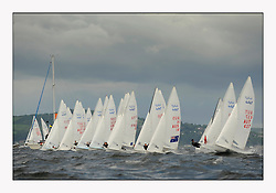 470 Class European Championships Largs - Day 3.Brighter conditions with more wind...Men Startline.
