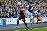 Joe Martin of Millwall (r) kicks Jamie Proctor of Bradford City while attempting to kick the ball . Skybet football league one play off semi final 2nd leg match, Millwall v Bradford city at The New Den in London on Friday 20th May 2016.<br /> pic by John Patrick Fletcher, Andrew Orchard sports photography.