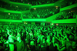 """© Licensed to London News Pictures . 05/02/2016 . Manchester , UK . Crowd . """" Hacienda Classical """" debut at the Bridgewater Hall . The 70 piece Manchester Camerata and performers including New Order's Peter Hook , Shaun Ryder , Rowetta Idah , Bez and Hacienda DJs Graeme Park and Mike Pickering mixing live compositions . Photo credit : Joel Goodman/LNP"""
