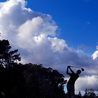 A dramatic cloudscape rises above San Lorenzo Valley High golfer Taj Yanez as he tees off on the ninth hole at Delaveaga Golf Course Tuesday during SLV's match against Scotts Valley. Scotts Valley won the match 204-234.<br /> Photo by Shmuel Thaler <br /> shmuel_thaler@yahoo.com www.shmuelthaler.com