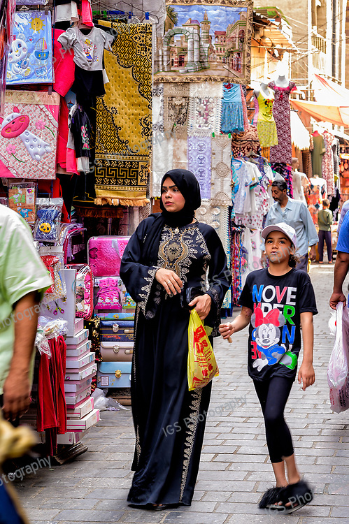 Traditionally dressed local shoppers in the Khan El Khalili market in Cairo during Ramadan