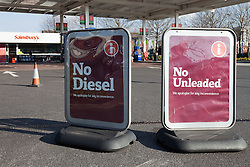 © licensed to London News Pictures. Salford, UK 01/04/2012. Petrol stations continue to run out of fuel. This Sanisbury's filling station in Salford, normally busy on a Sunday afternoon, sold out of both unleaded and diesel fuel and had to place printed signs at the entrance of its forecourt to deter motorists from queuing. This despite an announcement by the union, Unite, that there is no immediate plan for a fuel strike and updated advice from the government stating there is no urgent need for motorists to top up their fuel tanks. Please see special instructions for usage rates. Photo credit should read Joel Goodman/LNP