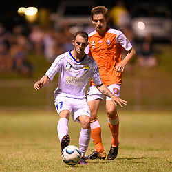 BRISBANE, AUSTRALIA - FEBRUARY 10: Nicholas Panetta of United controls the ball in front of Emlyn Wellsmore of the Roar during the NPL Queensland Senior Mens Round 2 match between Gold Coast United and Brisbane Roar Youth at Station Reserve on February 10, 2018 in Brisbane, Australia. (Photo by Football Click / Patrick Kearney)