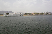 India, Rajasthan, Udaipur A boat ride in lake Pichola, the Taj Lake palace hotel in the background.