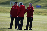 Warren Gatland , the Wales rugby team head coach ® assistant coaches Neil Jenkins (l) and Robert Howley © during the Wales rugby team training session at the Vale Resort  in Hensol, near Cardiff , South Wales on Tuesday 20th February 2018.  the team are preparing for their next NatWest 6 Nations 2018 championship match against Ireland this weekend.   pic by Andrew Orchard
