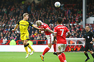 Burton Albion defender Jamie Allen (4) heads at goal during the EFL Sky Bet Championship match between Nottingham Forest and Burton Albion at the City Ground, Nottingham, England on 21 October 2017. Photo by John Potts.