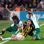 Fenerbahce's Mehmet TOPUZ (C) and Konyaspor's Alvaro Mejia PEREZ (L) during their Turkish superleague soccer match Fenerbahce between Konyaspor at the Sukru Saracaoglu stadium in Istanbul Turkey on Sunday 13 March 2011. Photo by TURKPIX