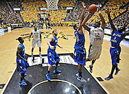 WICHITA, KS - JANUARY 18:  Forward Darius Carter #12 of the Wichita State Shockers scores between defenders Manny Arop #3 and Khristian Smith #32 of the Indiana State Sycamores during the second half on January 18, 2014 at Charles Koch Arena in Wichita, Kansas.  Wichita State defeated Indiana State 68-48. (Photo by Peter Aiken/Getty Images) *** Local Caption *** Darius Carter;Manny Arop;Khristian Smith