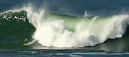 A contestant in the 2005 Mavericks big wave surfing contest stays in front of a giant wave, in Half Moon Bay, California, Wednesday, March 2, 2005.