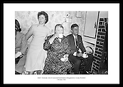 Picture shows President Kennedy sitting beside the fireside inside the homestead having a cup of tea.  On the left is Miss Josephine Ryan, daughter of Mrs. Ryan.  <br /> <br /> 27th June 1963
