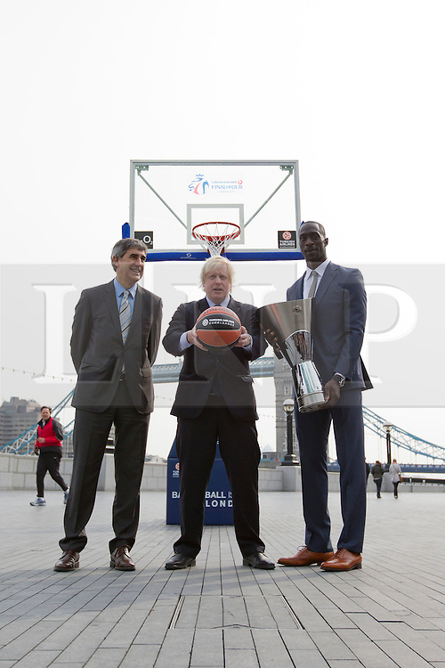 © Licensed to London News Pictures. 08/04/2013. London, UK. Boris Johnson, the Mayor of London (C), stands with Jordi Bertomeu, Euroleague Basketball President and CEO (L), and Pops Mensah-Bonsu of the Great Britain Basketball Team in London today (08/04/2013) during press call promoting the 2013 Turkish Airlines Euroleague Basketbal tour taking place at the O2. Photo credit: Matt Cetti-Roberts/LNP