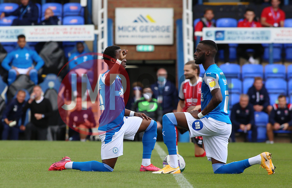 Siriki Dembele and Mo Eisa of Peterborough United take a knee in support of Black Lives Matter at kick-off - Mandatory by-line: Joe Dent/JMP - 05/09/2020 - FOOTBALL - Weston Homes Stadium - Peterborough, England - Peterborough United v Cheltenham Town - Carabao Cup