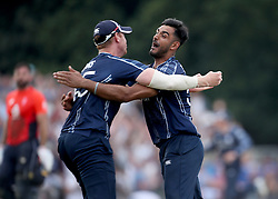 Scotland's Alasdair Evans (left) and Safyaan Sharif celebrate beating England in the One Day International at The Grange, Edinburgh.