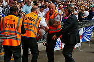 Stewards remove a Tranmere Rovers fan during the EFL Sky Bet League 2 Play Off Final match between Newport County and Tranmere Rovers at Wembley Stadium, London, England on 25 May 2019.
