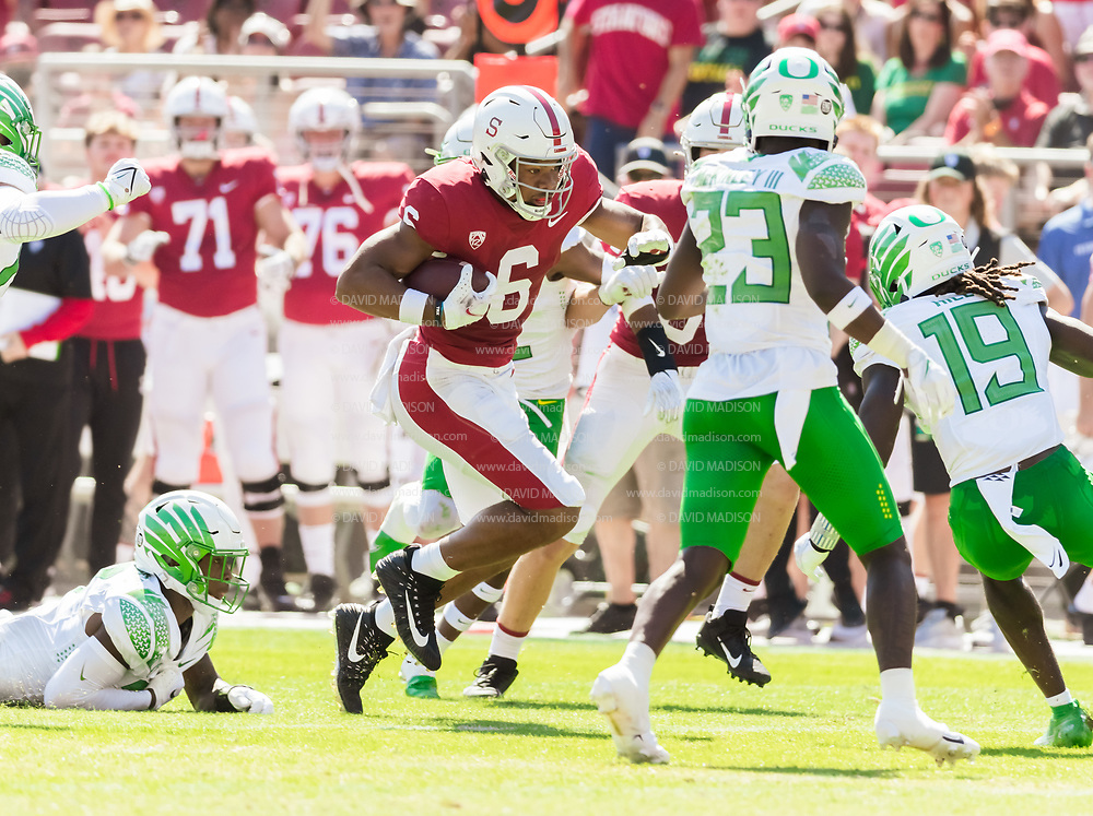 PALO ALTO, CA - OCTOBER 2:  Elijah Higgins #6 of the Stanford Cardinal runs after a pass reception during an NCAA Pac-12 college football game against the Oregon Ducks on October 2, 2021 at Stanford Stadium in Palo Alto, California.  (Photo by David Madison/Getty Images)