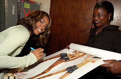 Kelly Rowland signing autographs back stage before getting changed for her solo show at Sheffield City Hall<br /> 20 Spetember 2003<br /> image copyright Paul David Drabble