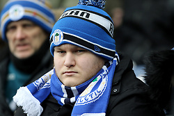 A Wigan fan in the stands appears dejected during the match