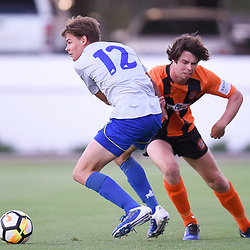 BRISBANE, AUSTRALIA - JANUARY 8: Braedon Steel of Strikers is tackled by Alex Barnett of Easts during the Kappa Silver Boot Group A match between Brisbane Strikers and Eastern Suburbs on January 8, 2017 in Brisbane, Australia. (Photo by Patrick Kearney)