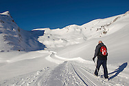 Walker in the winter Snow in the mountains near Grindelwald First - Swiss Alps - Switzerland