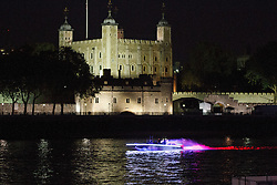 © Licensed to London News Pictures. 25/07/2012. London, UK. A colourful illuminated boat passes the Tower of London on 25 July 2012 in a rehearsal event believed to be related to the opening ceremony of the London 2012 Olympic Games. Photo credit : Vickie Flores/LNP