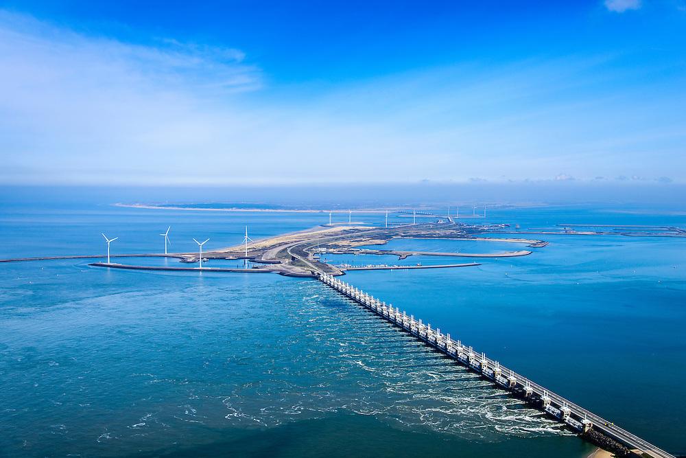 Nederland, Zeeland, Gemeente Schouwen-Duiveland, 01-04-2016; stormvloedkering Oosterschelde (Oosterscheldekering). Het is eb en het water stroomt van de Oosterschelde naar de Noordzee door het sluitgat Roompot.<br /> Eastern Scheldt storm surge barrier (Oosterscheldekering). It is low tide and the water flows from the Eastern Scheldt to the North Sea.<br /> <br /> luchtfoto (toeslag op standard tarieven);<br /> aerial photo (additional fee required);<br /> copyright foto/photo Siebe Swart