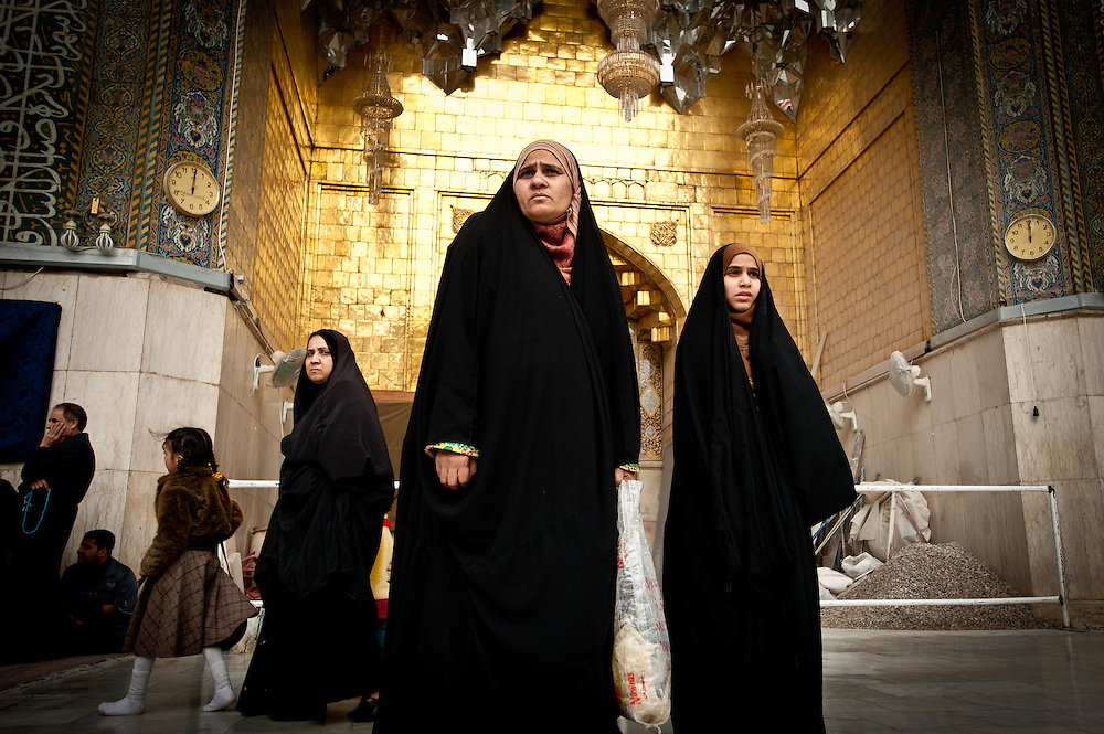 A mother and daughter at Friday prayers at the Kadhimiya Shrine in Baghdad, one of the holiest sites in the Shia tradition.