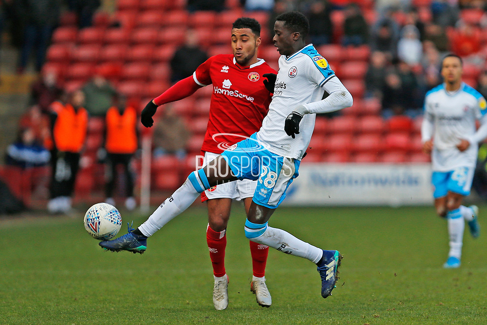 Panutche Camara and Wes McDonald compete for the ball during the EFL Sky Bet League 2 match between Walsall and Crawley Town at the Banks's Stadium, Walsall, England on 18 January 2020.