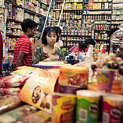 A Korean customer at a store in INA market New Delhi. The market is frequented by many foreigners and expats for its variety of imported products.