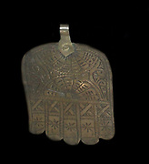 The hand of Fatima. Silver alloy metalwork from morocco. early 20th century. Islamic art. the fingers represent the Five Pillars of Islam. the hand wards away the evil eye