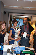 TOLULA ADEYEMI; PETER OGUNSALU; , Smythson Sloane St. Store opening. London. 6 February 2012.